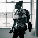 Givenchy Fitting Like Gym Clothes: Cam Newton Wears A Givenchy Camo Flower Paneled Tee-Shirt