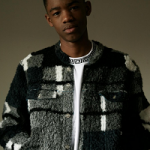 Model Montell Martin Poses In A Kenzo Fur Jacket From The Brand's Fall 2016 Collection