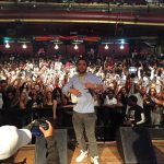 French Montana Performs In A Comme des Garçons Play Striped Tee-Shirt & Jon Buscemi Sneakers