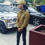 Swae Lee Outfitted In A Joyrich Leopard Print Grid Jacket & Cap And Alexander McQueen Velvet Embroidered Slip On Loafers