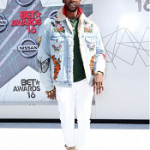 2 Chainz Wears A Gucci Embroidered Denim Jacket With Shearling, Cotton Polo With Web Collar & Check Jersey Embroidered Sweatshirt
