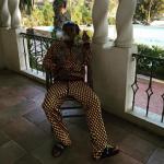 Slim Jxmmi Of Rae Sremmurd Wears A Gucci Graphic Print Jersey Jacket, Pants & Givenchy Rubber Slides