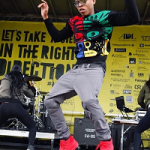 Bryshere Gray Performs In A Moschino Monkey Intarsia Jumper, Murray West Grey Motto Cargo Joggers & Balenciaga Arena Creased-Leather High Top Sneakers