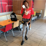 Rich The Kid Wears An Off-White Red 'White' Patchwork Tee-Shirt & Balenciaga Panelled Leather, Mesh & Neoprene Sneakers