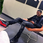 A-Boogie Dressed In A Balmain Rubber Logo Hooded Biker Hoodie & Christian Louboutin Men's Louis Flat High Top Sneakers