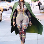 Fall Fashion In NYC: Lala Anthony Wears A Dsquared2 Samurai Tattoo Stretch Tulle Jumpsuit