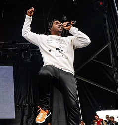 """07be3e8ca Pusha T Performs In An ENFANTS RICHES DÉPRIMÉS Crewneck   Wears A """"Chinese  Rocks"""" Jacket From The Brand"""