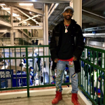 Big Sean Wears An Alexander Wang Shearling Collared Jacket & Gucci Embroidered Nature Denim Jeans