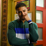Diggy Simmons Photographed In A Paul Smith Puppytooth Zip Neck Sweater