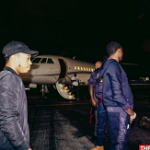 Meek Mill Wears A Balenciaga Logo Intarsia Hem Cotton Jersey Hooded Sweatshirt And Logo Joggers On A Private Jet