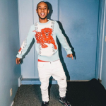 Slim Jxmmi Spotted In A $980 Gucci Leopard Intarsia Wool Crew Neck Sweater & $950 Gucci Cotton 'Tiger' Sweatshirt