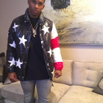 NFL Style: Victor Cruz Wears A $4,750 Moncler x Thom Browne NYC Tribute US Flag 10 Reversible Jacket