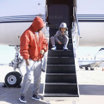 Flying In Style: Future Wears A $2,390 Vetements Hooded Shell Bomber Jacket & $595 Gucci 'Dublin' Slip-On Sneakers On A Private Jet
