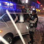 Dave East Takes The Snow Blizzard In An OFF-WHITE C/O Virgil Abloh Colorblock Leather Jacket & Black & White Striped Tee-Shirt
