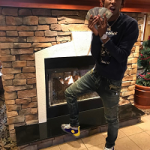 Rich The Kid Spotted In A Gucci Embroidered Loopback Sweatshirt & Balmain Blue Washed Denim Biker Jeans
