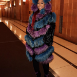 Female Rapper Trina Draped In A Helen Yarmak Hooded Fox Fur Coat & Giuseppe Zanotti Glitter & Crystals Embellished Ankle Boots