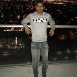NBA Style: Tyler Ulis Wears A Kenzo 'Runway' Sweatshirt & Balmain Blue Washed Denim Biker Jeans