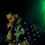 Rapper Dave East Performs In A Gucci Wool Sweater With Embroideries
