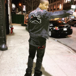 Juelz Santana Outfitted In A Gucci Denim Jacket With Embroideries & Denim Tapered Pants With Panther