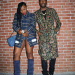 Meek Mill Outfitted In A Gucci Floral Cotton Blend Appliquéd Top Coat, Ace Jacquard Sneakers, Jersey Bomber Jacket With Panther And Snake Print Tee-Shirt