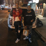 Dave East Outfitted In An Amiri Silk Satin Baseball Jacket, 'Silver Bullet' Air Max 97s Sneakers, Off-White Hoodie & Raf Simons adidas Originals Edition Ozweego Bunny Sneakers