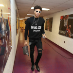 NBA Style: Kelly Oubre Jr. Wears A Givenchy 'I Feel Love' Sweater