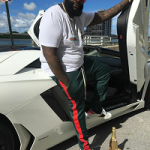 Rapper Rick Ross Wears Gucci & EPTM Green Track Pants