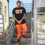 "DJ Boof Dressed In An Off-White c/o Virgil Abloh ""OFF"" Cotton Tee-Shirt, Coolux Halloween Trackpants & Air Jordan 1 Retro High Og ""Shattered Backboard"""