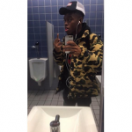 """Rising New York Rapper Grimm Guapo Wears An 'A Bathing Ape' Camo Puffer Jacket ; Releases """"We Fell In Love At The Party"""""""