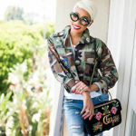 Monica Brown Accessorizes Her Outfit With A Gucci 110th Anniversary GG Marmont Small Dragon Velvet Shoulder Bag