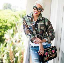 86bcd40af Monica Brown Accessorizes Her Outfit With A Gucci 110th Anniversary GG  Marmont Small Dragon Velvet Shoulder Bag – dmfashionbook.com