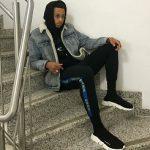 Jared Cunningham Wears A Kenzo Black Eye Hoodie, Balenciaga Men's Knit High-Top Sneakers & IKEA X INKLAW Sweatpants