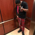 Dave East Wears Fear Of God Red Tartan Plaid Drawstring Trousers & Balenciaga Triple S Trainers