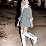 Monica Brown Outfitted In A Monse Herringbone Jacket With Belt & Off-White – For Walking Printed Leather Over-The-Knee Boots