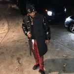 T.I. Wears A Burberry Down-filled Sleeve Wool Blend Duffle Coat & Fear Of God Red Tartan Plaid Drawstring Trousers