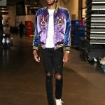 NBA Style: Brandon Ingram Outfitted In A Gucci Men's Bomber With Bosco And Orso & Amiri Trasher Jeans