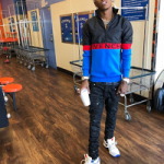 Rich The Kid Stepped Out In A Givenchy Half-Zip Colorblock Jacket & White 1952 Star Trainer Sneakers