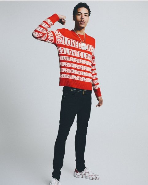 674019d7878c NEW YORK — Brooklyn-native and rapper Jay Critch dressed in a $965 Gucci  Red And White Loved Sweater, styled with black jeans. He completed his look  with a ...