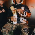 A-Boogie Wit Da Hoodie Bundled-Up In A Gucci Hooded Nylon Caban Down Jacket Styled With Amiri Camo Skinny Trousers