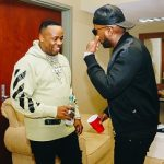 Yo Gotti Spotted In An Off-White Beige And Black Champion Edition Logo Hoodie