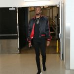 NBA Fashion: Andrew Wiggins Spotted In An Amiri Reversible Silk Bomber Jacket, Balenciaga Men's Knit High-Top Sneakers, Off-White Varsity Jacket And Christian Louboutin Men's Yang Louis Flat Leather Sneakers