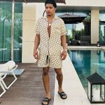 Justin Combs Spotted Poolside In A Gucci All-Over Logo Stamp Shirt , Shorts And Balenciaga Printed Leather Slides