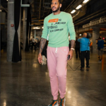 NBA Style: Carmelo Anthony Wears A Valentino Jamie Reid Slogan Intarsia Jumper And Heros Tribe 1 Mesh & Suede Sneakers