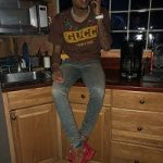 Rapper G Herbo Spotted In A Gucci x Dapper Dan Tee-Shirt & Raf Simons Sneakers