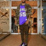 Rapper Fabolous Styles In A Faith Connexion Jewel Studded Camouflage Shirt And Amiri Frayed Knee Jeans