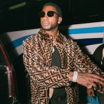 Rapper Gucci Mane Rocks A Fendi Reversible Logo-Print Shearling And Leather Bomber Jacket