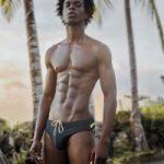 Model Yannick Konan Styles In A Pair Of Calvin Klein Swim Briefs And Allëdjo Button Down Shirts