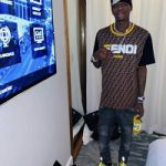 THE HOTTEST RAPPER IN THE GAME: Soulja Boy Wears A Fendi Brown Fendi Mania T-Shirt & Versace Chain Reaction Sneakers