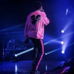 "A-Boogie Wit Da Hoodie Performs In An Amiri ""Lovers"" Skeleton-Heart Cotton Terry Sweatshirt And Broken Track Jeans in Acid Wash Black & Neon Pink"