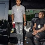 Rapper Lil Baby Spotted In A Dior Homme Atelier Logo T-Shirt
